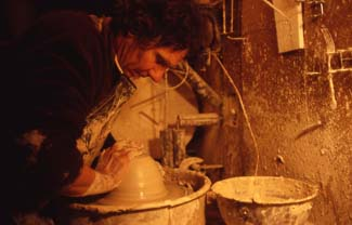 About Raku pottery - John Dodero forms pottery on a wheel at Dodero Studio Ceramics