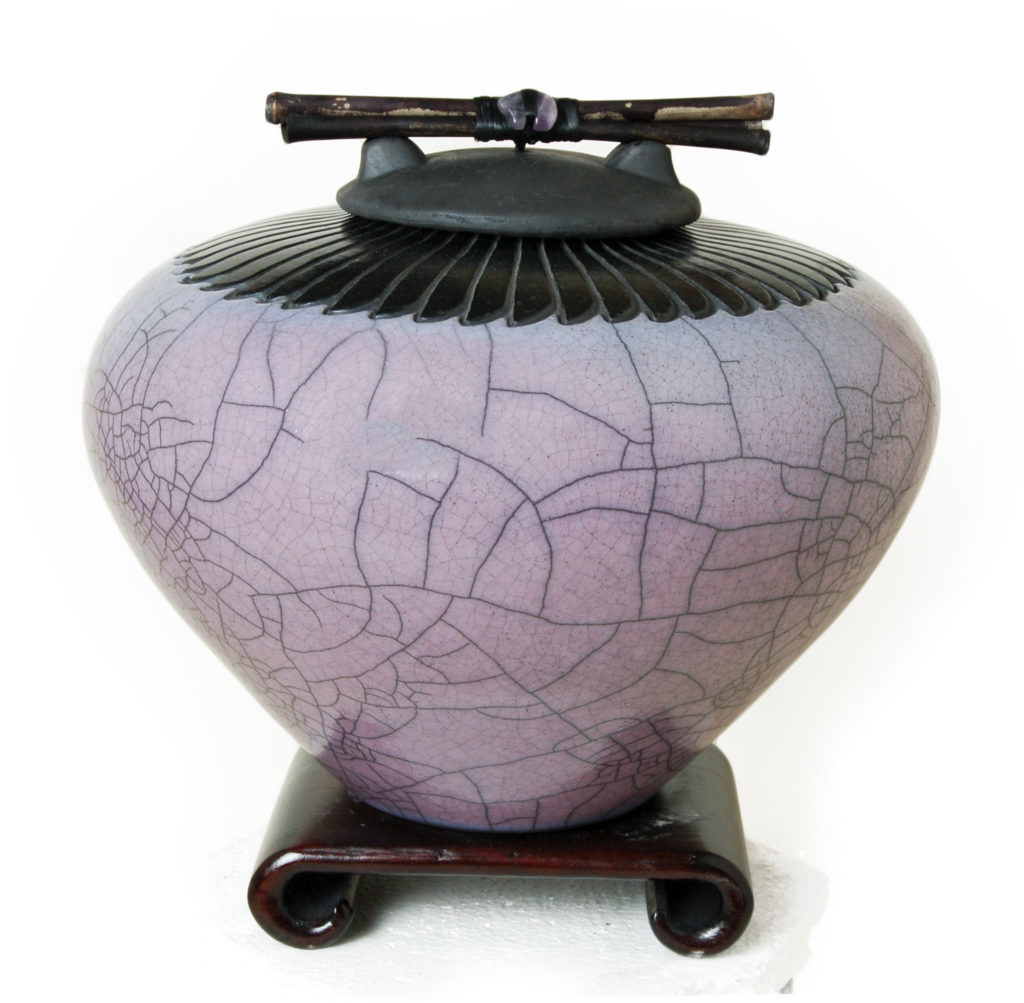 Urn Sizes and Volumes : Image of a dodero Studio Ceramics Raku urn with amethyst glaze